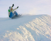 Snowboarder. Falling snowboarder on winter slope royalty free stock photography