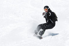 Snowboarder. With a lot of speed stock photos