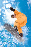 Snowboarder. Jumping high in the air royalty free stock photo