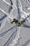 Snowboarder. Snowboarding in Caucasus Mountains in winter Stock Image