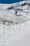 Snowboarder. Snowboarding in Caucasus Mountains in winter Royalty Free Stock Photo