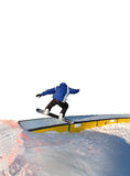 Snowboarder. A snowboarder on a curved rail Stock Images