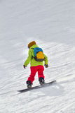 Snowboarder. Young snowboarder on the snow Stock Photos
