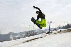 Snowboarder. Almaty. Snowboarder jumping on the bigair in the Tien Shan Royalty Free Stock Photo