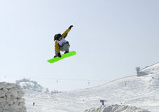 Snowboarder. Almaty. Snowboarder jumping on the bigair in the Tien Shan Royalty Free Stock Image