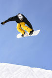 Snowboarder. Showing some tricks on a ski slope royalty free stock image