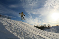 Snowboarder. Young snowboarder jumping royalty free stock photos