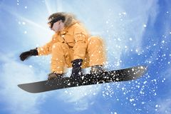Snowboarder. Jumping high in the air Stock Photos