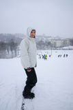 Snowboarder above a winter ski resort Stock Photo