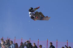 Snowboarder in action. Race World Cup snowboard Half Pipe in Valmalenco Italy Royalty Free Stock Images