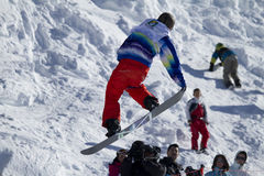 Snowboarder in action. Race World Cup snowboard Half Pipe in Valmalenco Italy Stock Image