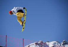 Snowboarder in action. Race World Cup snowboard Half Pipe in Valmalenco Italy Stock Photos