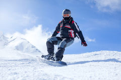 Snowboarder in action at the mountains Royalty Free Stock Image