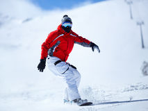 Snowboarder in action Stock Image