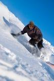 Snowboarder ad alta velocità, volo della neve Fotografie Stock