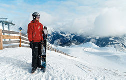 Snowboarder admiring the stunning view Stock Images