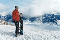 Snowboarder admiring the stunning view Stock Image