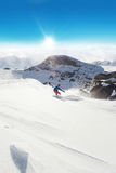 Snowboarder afname op piste stock afbeeldingen