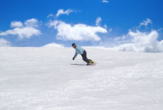 Snowboarder against blue sky Royalty Free Stock Photography