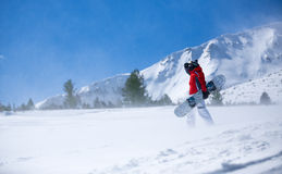 Snowboarder against panoramic winter mountains Stock Photography