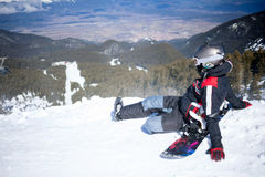 Snowboarder against panoramic winter mountains Stock Photo