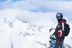Snowboarder against panoramic winter mountains Royalty Free Stock Images