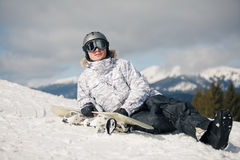 Snowboarder against sun and sky Stock Photo