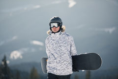 Snowboarder against sun and sky Stock Image
