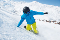 Snowboarder in the Alps. Snowboarder riding down the slope in the Alps Stock Photo