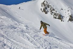 Snowboarder in the Alps royalty free stock photo