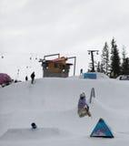Snowboarder at Arena Platos ski slope. Arena Platos, Paltinis, near Sibiu, Romania - 2 February 2013: Arena Freestyle Open - Ski and Snowboard competition taking Royalty Free Stock Photo