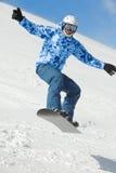 Snowboarder balances when flies on snowboard stock image