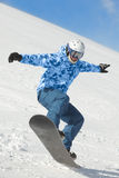 Snowboarder balances when lands after fly Royalty Free Stock Photos