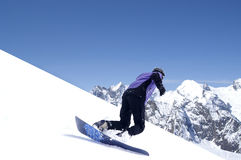 Snowboarder in Caucasus Mountains. Winter resort Dombaj Royalty Free Stock Photos