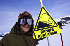 Snowboarder and Danger sign in ski station. Snowboarder face and Danger sign in ski station, Alps, Arêches, France Royalty Free Stock Photos