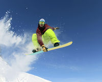 Snowboarder dans le ciel Photos stock