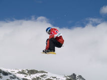 Snowboarder dans le ciel Photographie stock