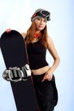 Snowboarder das mulheres nos óculos de proteção Fotografia de Stock Royalty Free