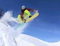 Snowboarder in de hemel royalty-vrije stock afbeelding