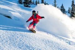 Snowboarder de la señora joven Imágenes de archivo libres de regalías