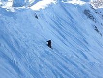 Snowboarder in den Alpen Stockfotos