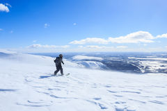 Snowboarder descent the snow mountain and picturesque polar landscape Stock Image