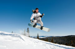 Snowboarder die door lucht springt royalty-vrije stock fotografie
