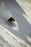 Snowboarder in diep poeder Stock Afbeeldingen