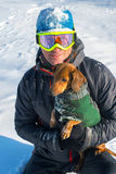 Snowboarder with dog Royalty Free Stock Photos