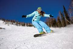 Snowboarder doing a toe side carve Royalty Free Stock Photo