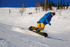 Snowboarder doing a toe side carve Stock Images
