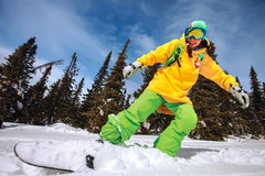 Snowboarder doing a toe side carve Stock Photography