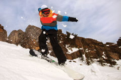 Snowboarder doing a toe side carve Stock Image
