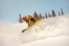 Snowboarder doing a toe side carve Stock Photos